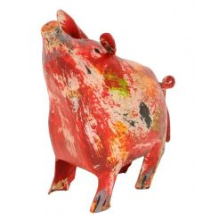 A colourful metal pig ornament filled with country charm.