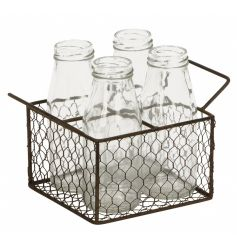 A set of 4 milk bottles with a rustic metal chicken wire tray with handles.