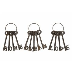 Charming LOVE, HOME and DREAM slogan keys. Rustic style decorative items for the home or garden.