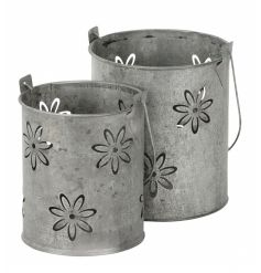 A set of 2 metal lanterns with a floral design. Ideal for t-lights, planting and decoration.