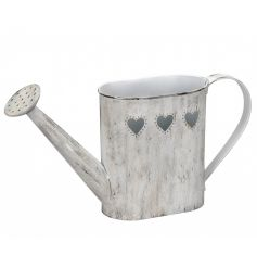 A rustic style grey watering can with heart cut out detailing. Perfect for planting and for decoration.
