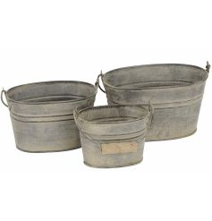 A set of 3 rustic metal bucket planters with wooden handle. Ideal for storage, decoration and planting.