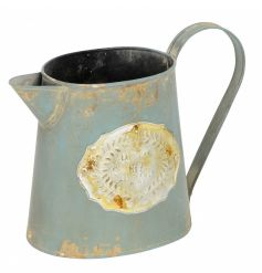 A vintage Parisian inspired jug in blue with a distressed finish. Ideal for planting and display.