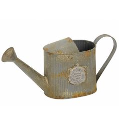 An antique inspired rustic watering can with Paris emblem. A rustic garden accessory, which is also ideal for planting.