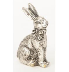 An antique style silver rabbit ornament with bow. A charming decorative accessory for the home.