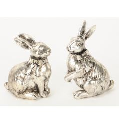 An assortment of 2 antique silver effect rabbit ornaments each with a bow.
