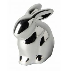 A decorative silver bunny ornament with a shiny finish.