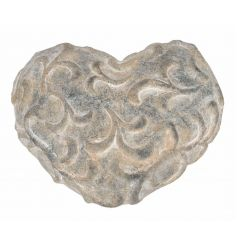 A rustic style decorative stone heart with 3D pattern. A chic accessory for the home or garden.