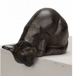 A charming cast iron cat decoration. A unique shelf sitter for cat lovers!
