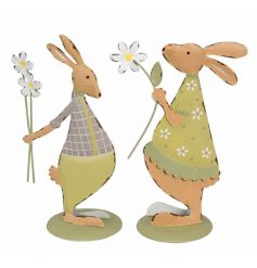 An assortment of 2 colourful metal rabbit decorations with Spring daisies.