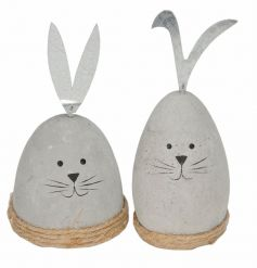 An assortment of 2 charming rabbit ornaments with metal ears and jute string bases.