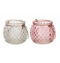 A mix of 2 vintage inspired clear and pink t-light candle holders with copper handles.