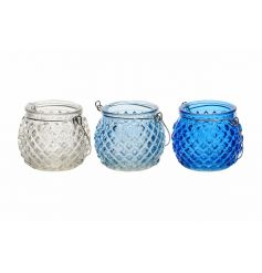 3 assorted cut glass blue and clear t-light lanterns with silver wire handles.