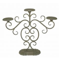 A rustic style candelabra in grey, ideal for holding 3 candles.
