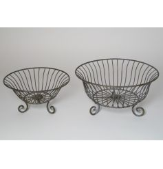 A set of 2 stylish planters and storage baskets in a rustic grey finish. Each includes an elegant stand.