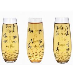 An assortment of 3 glamorous stemless champagne flutes in a gold bubble design with champagne slogans.