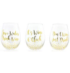 A mix of 3 slogan stemless wine glasses in gold.