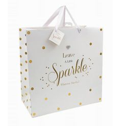 Leave a little sparkle wherever you go! A fine quality polka dot gift bag with gem heart and matching gift tag.