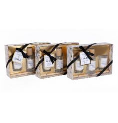 A mix of 3 glamorous gold scented gift sets including a reed diffuser and two scented candles.