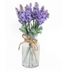 A stylish floral arrangement of lavender set within a glass bottle with a jute string bow.