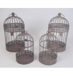 Display candles, flowers, trinkets and more in this set of 2 charming bird cages with hanger.