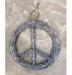 A rustic style rattan wreath in the peace design. An on trend item for the home or garden.