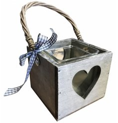 A charming grey wooden lantern with a rattan handle, heart cut out design and chic gingham bow.