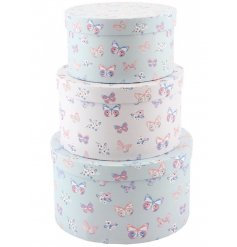 A set of 3 round storage boxes in pink and blue designs.