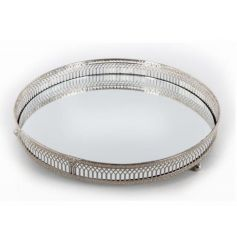 A silver mirror trinket plate. Ideal for displaying candles, jewellery and more.