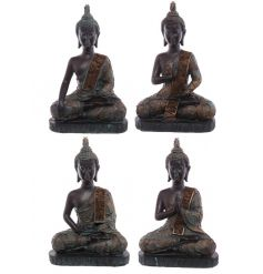 A mix of stylish sitting buddha ornaments in rich copper and turquoise colours. A chic home accessory.