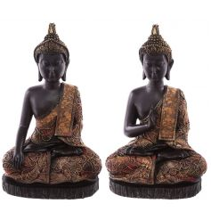 A mix of two luxury style buddha figures in black and copper gold colours. A chic home accessory.