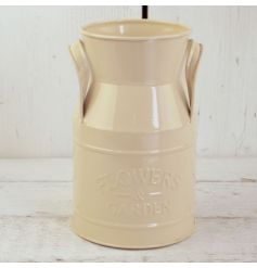 A rustic style milk churn in cream with an embossed Flowers and Garden design.