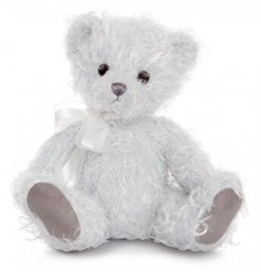 A luxuriously soft and adorable teddy bear with a fluffy fleece coat and white bow.