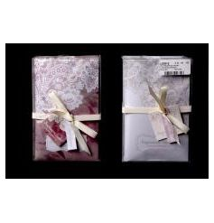 A mix of 2 beautifully designed scented sachets in purple and white colours.