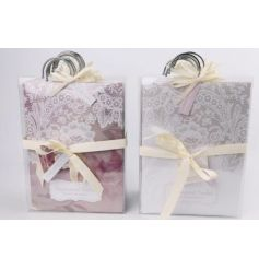 A mix of two fresh scented sachets with hangers. Each has a pretty lace design.
