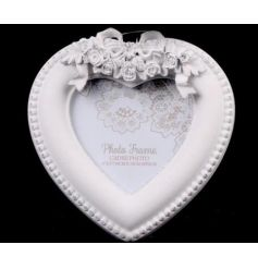 Add a simplistic elegant touch to your home with this sweet heart frame