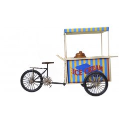A vintage ice-cream tricycle model with a retro style finish