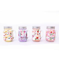 A mix of 4 pretty pastel coloured floral design candles set within mason jars.