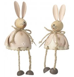 An assortment of 2 adorable pink and cream metal rabbit shelf sitters.