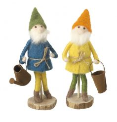 An assortment of 2 charming felt gnome ornaments with bucket and watering can. Both are sat upon a wooden base.