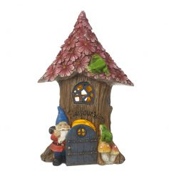 An enchanting solar powered light up fairy tree house with gnome, mushroom and frog ornaments.