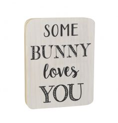 A shabby chic style wooden block sign with a 'some bunny loves you' slogan.