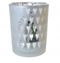 A glass silver tealight holder with hearts and kissing couple