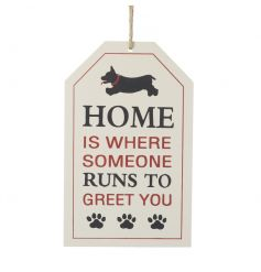 An adorable wooden sign with dog illustration and a 'home is where someone runs to greet you' slogan.
