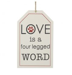 Love is a four legged word. A charming wooden sign with jute string hanger. A great gift item for dog lovers.