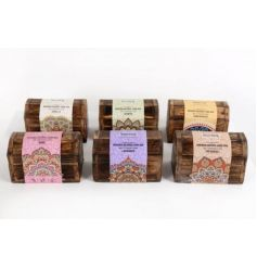 An assortment of wooden boxes each filled with delightfully scented incense cones.