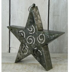 A distressed inspired metal star shaped t-light holder with a standing or hanging feature