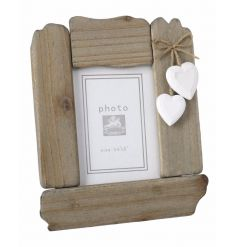 A shabby chic style wooden photo frame with two hanging hearts.