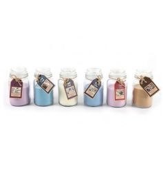 A mix of miniature candle jars filled with coloured scented wax. A great gift item and home fragrance.