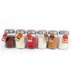 An assortment of sweet scented candles set within jam jars. A great gift item and home fragrance.